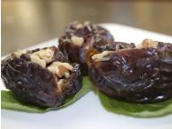 Dates stuffed with cacao nibs and walnuts