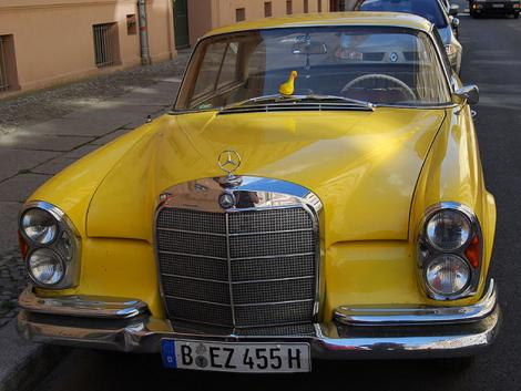 The yellow Mercedes