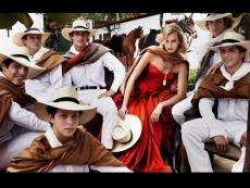 Karlie Kloss poses with Caballos de Paso for Vogue photoshoot