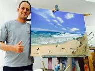 Flavio Caporali auctioning painting of the World Surfing Games
