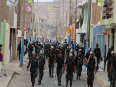 1,000 police clash with protesters over Tia Maria