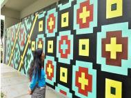 Murals by Cantagallo artists decorate San Isidro
